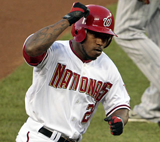 Willie Harris knocks a three-run shot in the second inning and ends up with four RBI.  (AP)