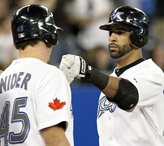 Jose Bautista goes deep twice for a total of five RBI, which matches a career high.  (AP)