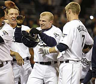 David Eckstein may be small in size but he smacks the biggest hit of the game for the Padres. (AP)