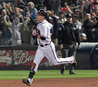 After a pair of Atlanta homers in the ninth, Nate McLouth follows suit with a walk-off shot in the 10th inning.  (AP)