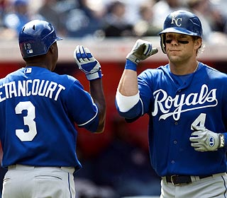 Alex Gordon -- with teammate Yuniesky Betancourt -- goes 0 for 3 before hitting the game winner. (AP)