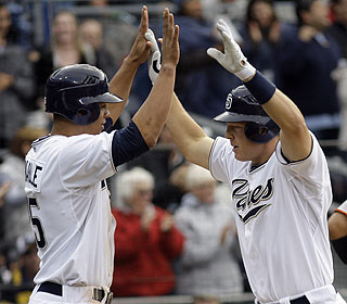 Nick Hundley (right) celebrates with teammate Will Venable after his two-run shot in the fifth. (AP)