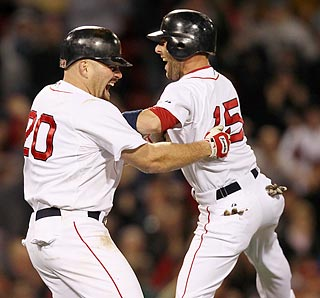 Dustin Pedroia begins the revelry after Kevin Youkilis finishes another thriller with a double.  (AP)