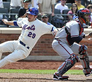 Ike Davis slides home on Jeff Francoeur's double to score the go-ahead run in the seventh.  (AP)
