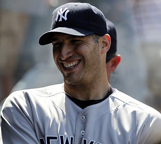 Andy Pettitte is all smiles in the dugout after tossing eight strong innings against the Angels.  (AP)