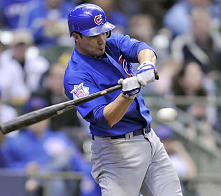 Ryan Theriot, who provides five hits and three RBI, improves to 14 of 25 in his last five games.  (AP)