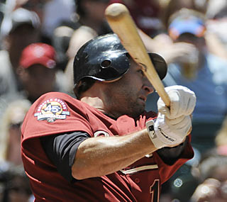 Lance Berkman kicks off the bottom half of the second with his first home run of the season.  (AP)