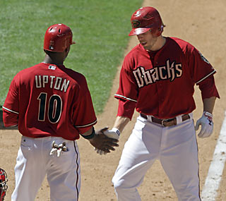 Justin Upton congratulates Mark Reynolds on his three-run HR. Reynolds records a season-high four RBI.  (AP)