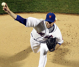 The Mets' Mike Pelfrey improves to 4-0 and moves his scoreless streak to 24 innings.  (Getty Images)