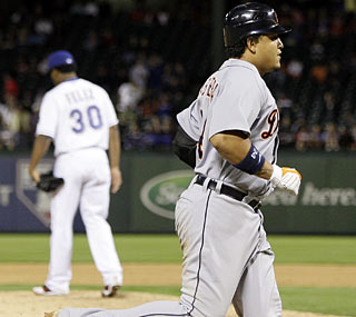 Miguel Cabrera rounds the bases after connecting off Rangers phenom Neftali Feliz (background).  (AP)