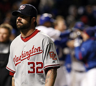 Nationals' reliever Brian Bruney doesn't share in the fun the Cubs are having after their walk-off win.  (AP)