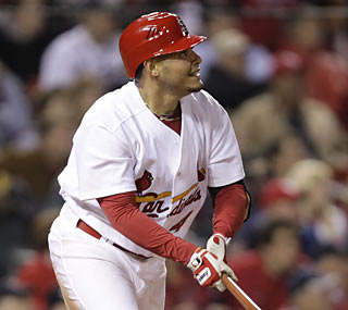 Yadier Molina hurts the Braves with this tiebreaking RBI double in the eighth inning.  (AP)