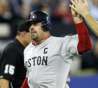 Jason Varitek joins the party with four RBI as the Red Sox set season highs for runs and hits.  (US Presswire)