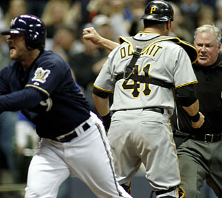 Milwaukee's Gregg Zaun, who belts four hits and five RBI, likes the safe call at home plate.  (AP)