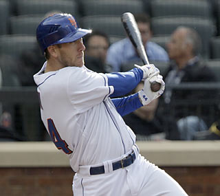 The Mets' Jason Bay watches the ball sail out of the park for his first dinger of the season.  (AP)