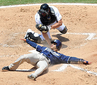 Jerry Hairston Jr. slides into home safely, beating Ronny Paulino's attempted tag in the fifth.  (US Presswire)