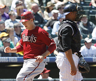 Kelly Johnson provides the D-Backs' go-ahead run with a solo shot in the 10th. (AP)