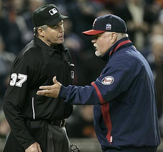 Ron Gardenhire loses this argument with Gary Darling, and eventually the game to a division rival.  (AP)