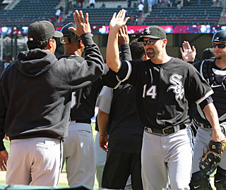 Paul Konerko (14) gives the ChiSox reason to high-five after his ninth and 10th HRs of the year.  (US Presswire)