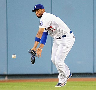 Matt Kemp misplays Ryan Doumit's line drive into a two-run triple that decides the outcome.  (US Presswire)