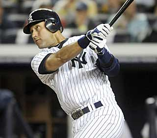 Yankee captain Derek Jeter comes up with big hits in the fifth and seventh to lead New York. (AP)