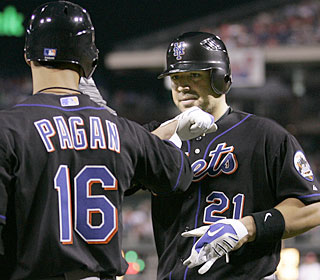 Rod Barajas enjoys a power surge Friday night, crushing two homers for the surging Mets.  (AP)