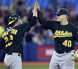 Josh Donaldson (left) greets closer Andrew Bailey after a memorable day for the rookie catcher.  (AP)