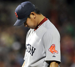 Daisuke Matsuzaka gives up seven runs -- six earned -- in his first outing of the season.  (AP)