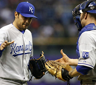 Royals closer Joakim Soria escapes some trouble in the 11th to earn his seventh save.  (AP)
