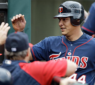 Wilson Ramos joins Kirby Puckett in Twins history by collecting four hits in his debut.  (AP)