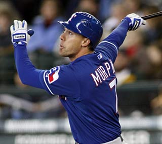 David Murphy ties the game in the ninth and provides the winning margin in the 11th for Texas.  (AP)