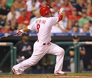 Shane Victorino blasts a grand slam in the Phils' two-out, nine-run rally in the fourth.  (Getty Images)