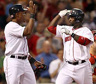 Both Adrian Beltre (left) and Bill Hall hit their first home runs as Red Sox in the rout of the Angels. (AP)