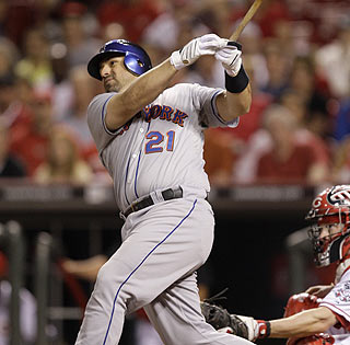Rod Barajas admires the flight of his ninth-inning homer that caps the Mets rally.  (AP)