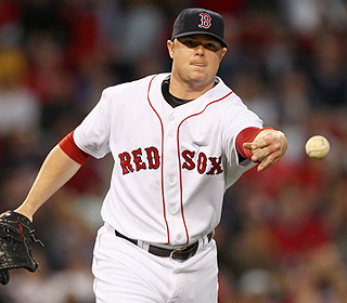 Jon Lester strikes out five in eight innings as he evens his record to 2-2 on the season. (AP)