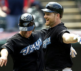Adam Lind (right) celebrates with Aaron Hill after his two-run HR, which comes in the ninth with two outs. (AP)