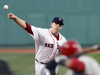 John Lackey, who spent 2002 through 2009 with the Angels, allows only four of 25 batters to reach base.  (AP)
