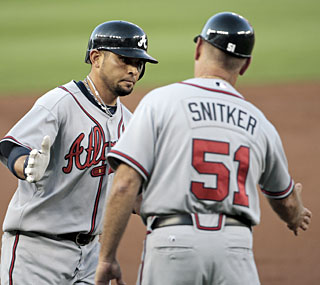 Atlanta's Omar Infante smacks a two-run drive in the second to put the Braves ahead momentarily.   (AP)