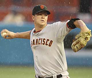 Matt Cain doesn't let a little bit of rain stop him from throwing into the eighth inning. (AP)
