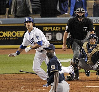 Andre Ethier and LaTroy Hawkins watch the game-ending grand slam sail over the center-field fence.  (AP)