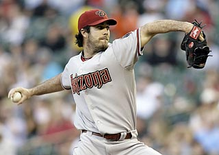 After allowing a leadoff double, Dan Haren sets the tone by fanning seven of the next nine batters.  (US Presswire)
