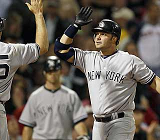 Nick Swisher gets the scoring going for the Yankees by hitting a three-run homer in the fourth. (AP)