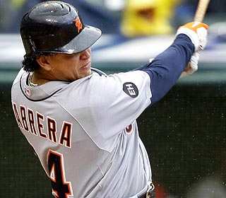 Miguel Cabrera hits a two-run bases-loaded single off Kerry Wood, who's making his season debut. (AP)