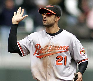 Nick Markakis, awaiting high-fives, drives in three of the O's five two-out runs off Twins ace Francisco Liriano. (AP)