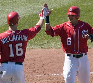 Ian Desmond (right) comes home for the winning run as the Nationals finish off the Marlins.  (AP)