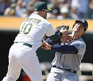 Not only does Daric Barton drive in two runs for the A's, he also prevents the Rays from scoring in the 7th. (AP)