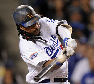 Manny Ramirez singles in four at-bats in his first action after missing 14 games.  (AP)