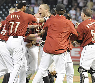 Hunter Pence is mobbed by teammates after hitting a walk-off double in the 11th inning.  (AP)