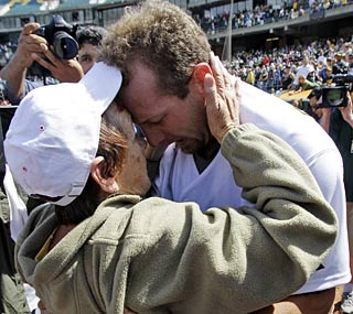 Dallas Braden embraces his grandmother, Peggy Lindsey, who helped raise him after his mother died.  (AP)