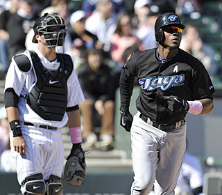A.J. Pierzynski and Fred Lewis get a good long look at Lewis' three-run blast that lifts the Jays.  (AP)